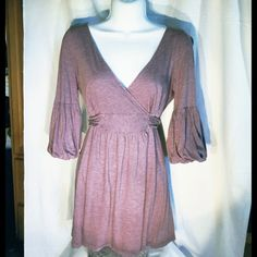 Juicy Couture Tunic Other than a small hole (see inside star on second pic) this top is in great condition! Juicy Couture Tops Tunics
