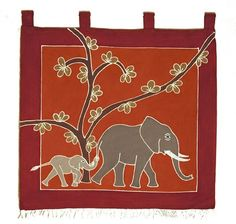 This African wall hanging is made from cotton and features a Mother and baby Elephant design on an earth brown coloured background.