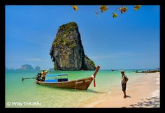 Railay beach in Krabi can only be accessed by longtail boat...  More at http://facebook.com/phuket101/