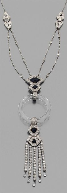 An Art Deco platinum, rock crystal, onyx and diamond necklace, 1930s. #ArtDeco #necklace