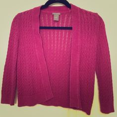 Magenta Crocheted Cropped Cardigan Ann Taylor magenta colored crocheted, cropped open front cardigan with 3/4 length sleeves. Can be worn with pants or over a dress or skirt! 55% linen, 45% cotton Ann Taylor Sweaters Cardigans