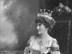 Mary Caroline, Countess of Errol, wearing a diamond tiara, featuring many diamond pinnacles, each topped with a large circular diamond, all ready for the Coronation.