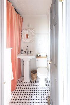 Small bathroom with bold drape as shower curtain.