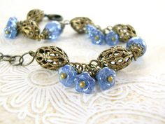 Floral Antiqued Brass Sapphire Blue Bracelet  by ArdentHearts