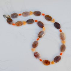 "Mixed Quartz and Agate faceted Oval, Carnelian, carved Butterfly Necklace. $44.00, via Etsy. This 27"" necklace is made with faceted ovals each measuring about 1 x 3/4"", faceted Carnelian 3/8 x 1/4"" ovals, tiny Quartz crystal rondelles and carved Cream Quartz butterfly beads. The necklace is fastened with a sterling silver toggle with an attached pewter heart charm. Charming!"