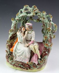 Beautifully executed Staffordshire lovers in arbor