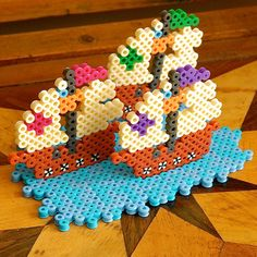 Columbus sailed the ocean blue in fourteen hundred and ninety-two! Here are his three ships—the Nina, the Pinta, and the Santa Maria—for you to create from Perler beads in honor of Columbus Day. 3d Perler Bead, Diy Perler Beads, Pearler Beads, Pony Bead Crafts, 3d Figures, Fusion Beads, Melting Beads, Perler Patterns, Pony Beads