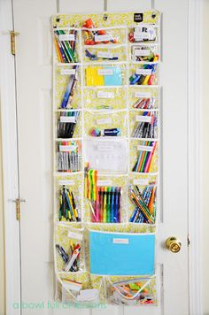 "Over the door school supplies organization. I am doing this for both kids. Tired of searching for pens, pencils, post its etc.  via ""A Bowl full of Lemons"" blog"