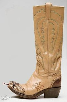 vintage cowboy boots with snake head!  I would freakin' scream every time I looked at my toes, and am almost certain I'd have nightmares after wearing those. If it were possible, I'd run right out of my boots. Can you imagine- you'd run and those dang rattlesnake heads would be chasing you the whole way. Man, those are a perfect example of how amazingly creative people can be, but I don't think I could even let those in my house. :) Love 'em and hate 'em all at once. ;)