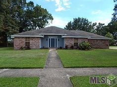 Outstanding value in one of the most established neighborhoods in Baton Rouge - Concord Estates.  This three bedroom, two and 1/2 bath home is built solid and features a new roof and HVAC system. The home sits an a large corner lot with mature trees and landscaping. Enter the front door into the grand foyer and there is a formal dining room to the right with a pass through to the kitchen which is large with lots of counters, custom cabinets, new appliances and is open to the dining area…