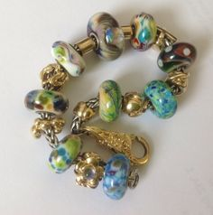 Trollstones and gold bracelet from a Danish collector on Trollbeads Gallery Forum.
