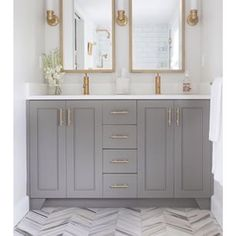 Instagram photo by bonniwhyteinteriors - Appreciating this contemporary take on a more traditional bathroom. The brass fixtures and fittings on that gorgeous mushroom grey is refined and sophisticated. I don't think need to mention how great the flooring is, as we know how I feel about herringbone. Ok, I bloody love it! Image via @interiorspaces