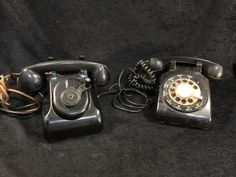 LOT INCLUDES AN OLD HAND CRANK ROTARY BLACK BAKELITE DESK PHONE AND A VINTAGE BELL SYSTEM WESTERN ELECTRIC ROTARY TELEPHONE.