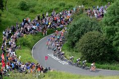 LONDON, ENGLAND - JULY 28: Tony Martin of Germany leads the peloton around a hairpin at the base of the climb as they make their way up Box Hill during the Men's Road Race Road Cycling on day 1 of the London 2012 Olympic Games on July 28, 2012 in London, England. (Photo by Jamie Squire/Getty Images)