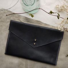 Black leather hand dyed clutch bag, ipad case, tablet holder, black clutch,envelope purse. Made in England by ToriLoDesigns on Etsy https://www.etsy.com/listing/246639780/black-leather-hand-dyed-clutch-bag-ipad