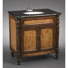 This vanity sink has a painted brown finish with a hand painted Grecian design and is accented with a black granite top and a white porcelain sink bowl. The storage area behind the two doors has a s Country Bathroom Vanities, Single Sink Bathroom Vanity, Bath Vanities, Country Bathrooms, Granite Tops, Black Granite, Porcelain Sink, White Porcelain, Vanity Set