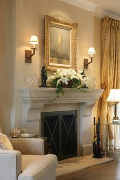 Fireplace mantle and surround design, sconces. Reaume Construction & Design.....love. Love! Fireplace. Stone mantel traditional french country