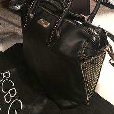 Gorgeous BCBG Black Leather w/ Gold Studs Purse Brand new and never used. Leather straps still in plastic. Comes with original BCBG dust bag. Real leather and has adjustable shoulder strap! BCBG Bags