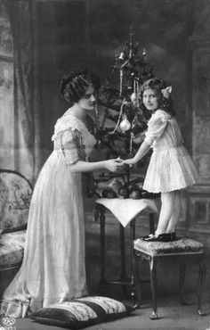 A mother and her daughter at Christmas, circa 1890.