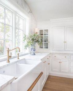 White kitchen cabinets and farmhouse sink! {Design: The Fox Group}