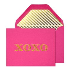 xoxo folded note is printed with gold foil on raspberry paper.