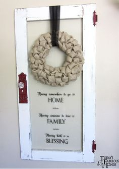 Dual-duty ... new use for old door.  Especially love the saying ... Having somewhere to go is HOME; Having someone to love is FAMILY; Having both is a BLESSING.  Beautiful!