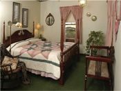 Grandma's Spring Room. Comfortable room located on main floor. Traditional Cherry Queen Poster bed with Amish quilt. Antiques. P. Buckley Moss Art. Private bath with tub/shower combo. Central A/C, WIFI. Lovely Country view. #MillerHaus