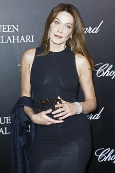 Carla Bruni-Sarkozy Photos - Carla Bruni Sarkozy attends The Garden of Kalahari Movie Presentation at Theatre du Chatelet on January 2017 in Paris, France. - Chopard Presents 'The Garden of Kalahari' Carla Bruni, Chopard, January 21, Beaded Clutch, Paris France, Theatre, Presentation, Presents, Movie