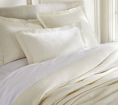 I like the tone-on-tone look of this set. No drinking red wine in bed! Emma Paisley Matelasse Coverlet & Sham #potterybarn