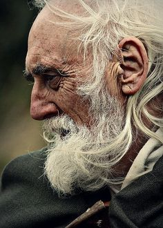 "spgent: "" I came upon an old man whose wrinkles seemed to trace the lines of the runes, retelling some ancient fable. """