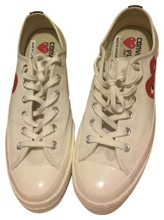 COMME Des GARONS Converse Low Tops Cream And Red Athletic Shoes. Get the must-have athletic shoes of this season! These COMME Des GARONS Converse Low Tops Cream And Red Athletic Shoes are a top 10 member favorite on Tradesy. Save on yours before they're sold out!