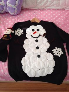 Snowman Sweater: If you are attending an ugly Christmas sweater party this year, we have got you covered! Here are 25 Ugly Christmas Sweater Ideas for you to use as inspiration.