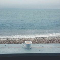 quiet and still in the rushing sound of the waves with a coffee and a smile.... life