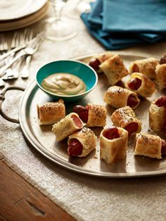 Feast on Finger Food-Offer your guests a tasty appetizer to snack on while you watch the celebs arrive. Party-goers will love these bite-sized pig in a blanket so much, they'll be gone before the show even starts.  Recipe: Pigs in a Blanket...    More hors d'oeuvres recipes