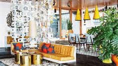7 Totally Lavish Celebrity Homes // Mid-century modern,  brass cocktail table, oversized lamp