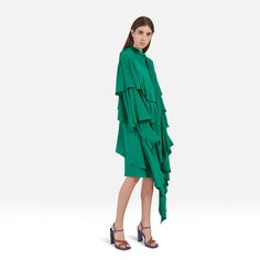 Shop the Dulcie Dress in Jade Silk at Mulberry.com. The Dulcie Dress is crafted from a vibrant jade silk crepe de chine. The three asymmetrical layers of ruffles create volume and a light, romantic silhouette, finished with a high neckline and pussy bow tie.