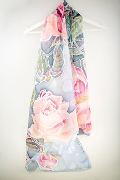 Hand painted silk scarf of Frosen Pink English Roses in Snow. Put this scarf on the shoulders and you got surrounded by Nature...: Frist frost... Soft flowers... Slow snow... Scarf is painted on Ponge Silk. It is light semiglossy but not transparent silk. Scarf size is 17 x 70 inches- 45x180cm This size is most comfortable and gives best look when is worn. All my scarved are hand hammed what makes hand made from the first step till the last one. A silk scarf is elegant accessory for dress...