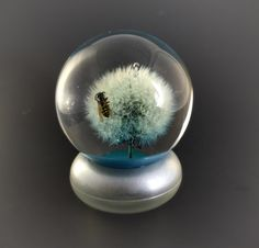 A personal favorite from my Etsy shop https://www.etsy.com/listing/271484050/large-dandelion-paperweight-nature
