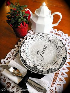 Using a calligraphy pen, write your guest's name on the paper doily under a clear glass plate.