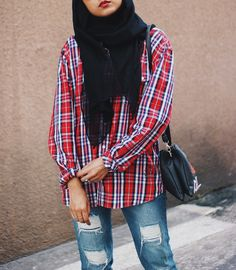 Plaid shirt and ripped jeans