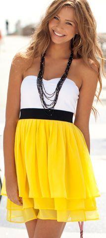 Pretty dress on a pretty girl.Two-tone dress,  black belt. White  yellow