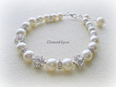 Bridal bracelet. Bridesmaid bracelet. Wedding pearl bracelet. Bridesmaid jewelry. Rhinestone pearl bracelet. Swarovski Pearls ivory. $25.00, via Etsy.