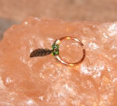 Hey, I found this really awesome Etsy listing at http://www.etsy.com/listing/175075866/small-nose-ring-copper-beaded-nose-ring