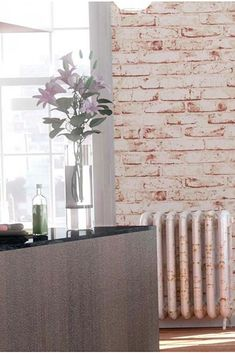 The matt brick pattern with its tactile relief feels robust and solid, lending a rustic charm to a living room or dining area. Rustic Charm, Rustic Style, Loft, Design Industrial, Rustic Wallpaper, Style Rustique, Bookcase Styling, Wall Mounted Light, Brick Patterns