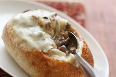Philly Cheesesteak Stew ~ tender beef and caramelized onions topped with gooey cheese in a bread bowl!