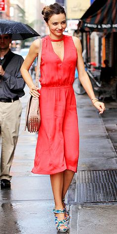 MIRANDA KERR  Miranda has been killing it all summer with her effortlessly chic street style and this latest look is no exception. We want everything she's wearing from her orange-red A.L.C. dress and studded Alexander Wang bag to those floral-print Balenciaga heels.