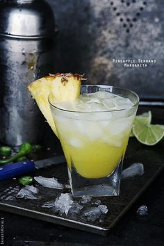 Pineapple Serrano Margarita  This is basically a Cadillac margarita but made sweeter with pineapples and balanced with a little heat from the serrano chilis. #margaritas #drinks #alcohol