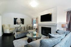 TV above fire place with mantel piece