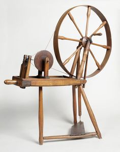 """""""Scottish muckle wheel""""  Interesting - a treadle wheel (with a crank/handle) that has spindle instead of a flyer and bobbin."""