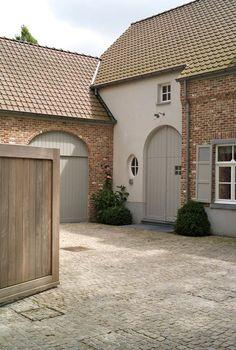 Brick plinths and patio/boundary walls, cobblestone hardiplank, grey/green paintwork